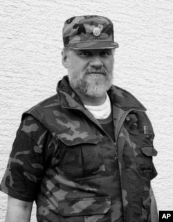 In this September 1991 photo, Slobodan Praljak poses near a front line in Sunja, Croatia. Praljak stunned the International Criminal Tribunal for the former Yugoslavia on Nov. 29, 2017, when he gulped down liquid from a small bottle seconds after a U.N. appeals judge had confirmed a 20-year sentence against him.