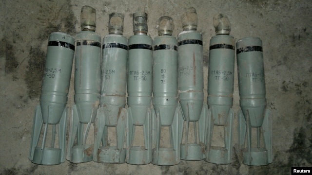 Cluster bombs, which activists say were dropped by a Syrian Air Force fighter jet, are displayed at Sowran near Aleppo in this October 30, 2012, file photo.