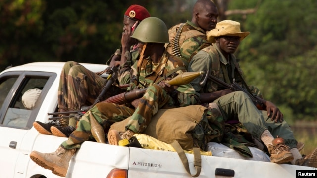 Seleka rebels ride in a truck as they leave their main base at Camp Deroux and head toward a smaller base in the PK12 neighborhood, in the north of the capital Bangui, Jan. 27, 2014.