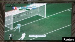 A video replay of France's Karim Benzema's goal using goal-line technology is pictured on a screen during their 2014 World Cup Group E soccer match against Honduras at the Beira Rio stadium in Porto Alegre, Brazil, June 15, 2014.