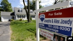 "A ""For Sale"" sign stands in front of a house in Walpole, Mass. On Thursday, July 7, 2016, Freddie Mac reports on the week's average U.S. mortgage rates."