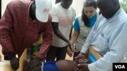 Medics near Garoua, Cameroon, evaluate Little Bossiran's height and weight to determine degree of malnourishment (VOA/D. Ntaryike)