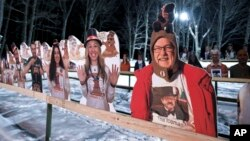 Cardboard cutouts of groundhog enthusiasts decorate Gobbler's Knob for the 135th celebration of Groundhog Day in Punxsutawney, Pa. Tuesday, Feb. 2, 2021. This year's event was held without anyone in attendance due to potential COVID-19 risks. (AP Photo/Ba