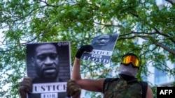 George Floyd protesters set Minneapolis police station afire