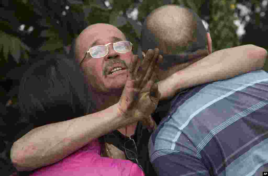 A man embraces his relatives after shelling in the town of Donetsk, eastern Ukraine.