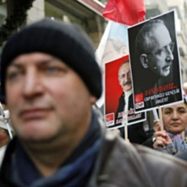 Supporters of the main opposition Republican People's Party (CHP) march with posters of their leader Kemal Kilicdaroglu during a protest against the government in central Istanbul, January 10, 2012