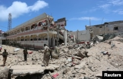 Security forces stand at the SYL hotel that was partly destroyed following a car bomb claimed by al Shabab Islamist militants outside the president's palace in the Somali capital of Mogadishu, August 30, 2016.