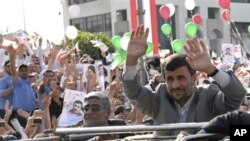 Iranian President Mahmoud Ahmadinejad waves to the crowds from the sunroof of his SUV upon his arrival in Beirut, Lebanon, 13 Oct 2010