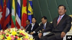 Cambodia's Prime Minister Hun Sen, right, sits during a meeting at Peace Palace in Phnom Penh, Cambodia, Thursday, July 28, 2011. Hun Sen on Thursday opened the third meeting with environment ministers from the Greater Mekong Subregion countries which con