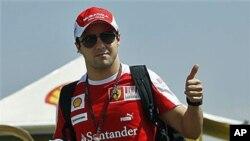 Ferrari Formula One driver Felipe Massa, of Brazil, gives the thumb-up at the Interlagos racing track, in Sao Paulo, Brazil, 04 Nov 2010. The Brazilian Formula One Grand Prix will be held 07 Nov 2010 in Sao Paulo.