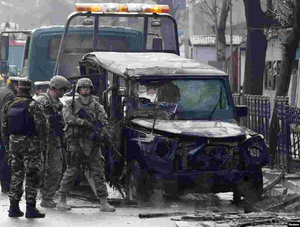 U.S. soldiers arrive at the site of a suicide attack in Kabul, Feb. 26, 2015.