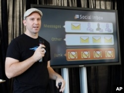 FILE - Andrew Bosworth, then a Facebook engineer, talks about the new Facebook messaging service in San Francisco, Nov. 15, 2010.