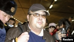 FILE - Kim Jong Nam arrives at Beijing airport in Beijing, China, in this photo taken by Kyodo, Feb. 11, 2007.