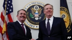 FILE - U.S. Trade Representative Robert Lighthizer, right, shakes hands with Britain's Secretary of State for International Trade Liam Fox as they arrive for a meeting at the Office of the U.S. Trade Representative in Washington, March 14, 2018.