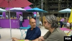 Flavio Nervegna, left, at Tous a Table restaurant, Paris, Aug. 2013. (VOA L. Bryant)
