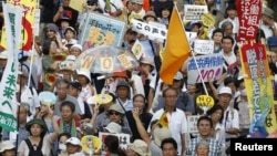 Anti-nuclear protesters march during a demonstration in Tokyo July 29, 2012.