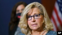 FILE - Rep. Liz Cheney, R-Wyo., the House Republican Conference chair, speaks with reporters following a GOP strategy session on Capitol Hill in Washington, April 20, 2021.