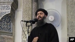 FILE - Image taken from video shows a man purported to be Abu Bakr al-Baghdadi, leader of the Islamic State militant group, delivering a sermon. In an audio recording released late Tuesday, he called on IS fighters in Mosul not to retreat in the face of approaching Iraqi and Kurdish forces.
