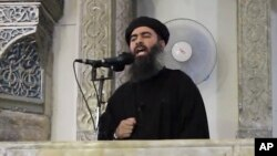 FILE - An image made from video posted on a militant website July 5, 2014, purports to show the leader of the Islamic State group, Abu Bakr al-Baghdadi delivering a sermon.