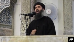 FILE - This image from video purports to show Islamic State leader Abu Bakr al-Baghdadi delivering a sermon in Iraq.