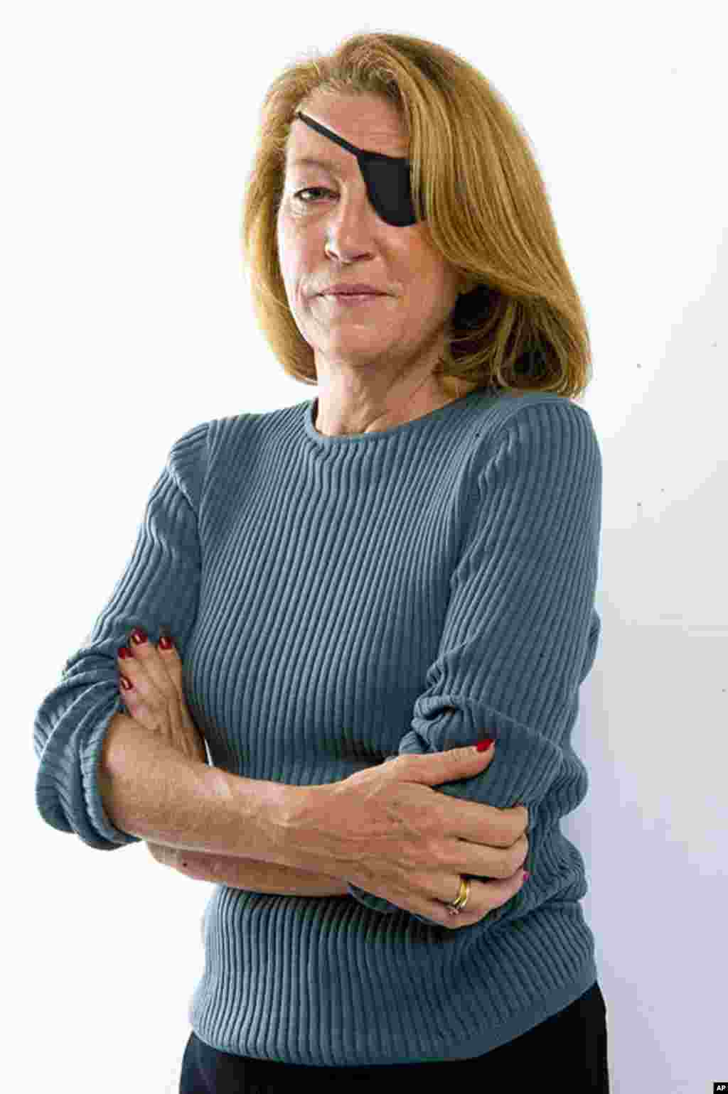 Award-winning American war reporter Marie Colvin was killed on February 22, 2012 by Syrian government shelling against the opposition stronghold of Homs, Syria. She was 57. (AP)