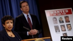 U.S. Attorney General Loretta Lynch and FBI Director James Comey hold a news conference to announce indictments on Iranian hackers for a coordinated campaign of cyber attacks on several U.S. banks and a New York dam, at the Justice Department in Washingto