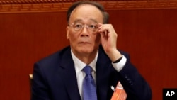 Wang Qishan, China's former anti-corruption czar and an official regarded as Chinese President Xi Jinping's right-hand man, attends the opening session of the annual National People's Congress in Beijing's Great Hall of the People, March 5, 2018.