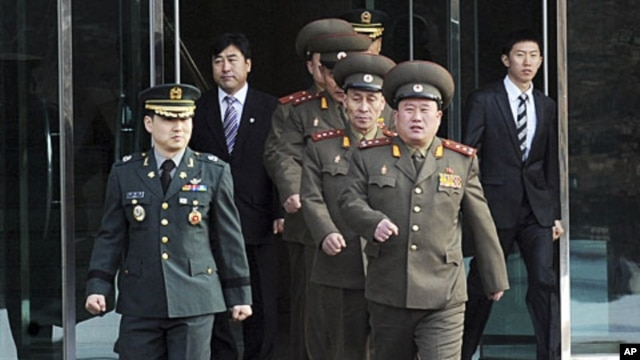 North Korean Colonel Ri Son-kwon (front R) and other North Korean officers walk south of the truce village of Panmunjom in Paju, north of Seoul, February 8, 2011