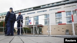Police officers secure the French Embassy in Berlin a day after the Paris attacks, Nov. 14, 2015.