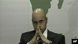 Saif al-Islam, son of longtime Libyan leader Moammar Gadhafi, speaks out in defense of his father and his regime, February 21, 2011.