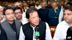 In this photo released by the National Assembly, the leader of Pakistan Tahreek-e-Insaf party Imran Khan,speaks at the National Assembly in Islamabad, Pakistan, Aug. 17, 2018.