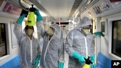 Workers disinfect subway trains against coronavirus in Tehran, Iran, in the early morning of Wednesday, Feb. 26, 2020. Iran's government said Tuesday that more than a dozen people had died nationwide from the new coronavirus, rejecting claims of a…