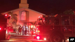 Firefighters work at the scene of a blaze at the Islamic Center of Fort Pierce, Florida, Sept. 12, 2016. (St. Lucie Sheriff's Office via AP)