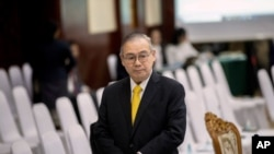 Philippines Foreign Affaires Secretary Teodoro Locsin Jr. walks ahead of the Special Meeting of Foreign ministers of The Association of Southeast Asian Nations (ASEAN) coordination council in Vientiane, Laos, Thursday, Feb. 20, 2020. (AP Photo…