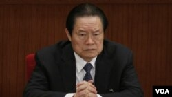 ທ່ານ Zhou Yongkang, ອະດີດສະມາຊິກຄະນະກົມການ ເມືອງສູນກາງພັກ ຄອມມິວນິສ ທີ່ຖືກລັດຖະບານສືບສວນ ໃນຂໍ້ຫາສໍ້ລາດບັງຫລວງ.