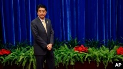 Japan's Prime Minister Shinzo Abe waits to meet China's President Xi Jinping, during their meeting at the Great Hall of the People, on the sidelines of the Asia Pacific Economic Cooperation meetings, in Beijing, Nov. 10, 2014.