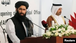Muhammad Naeem (L), a spokesman for the Office of the Taliban of Afghanistan, speaks during the opening of the Taliban Afghanistan Political Office in Doha, June 18, 2013.