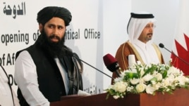 Muhammad Naeem (L), a spokesman for the Office of the Taliban of Afghanistan speaks during the opening of the Taliban Afghanistan Political Office in Doha, June 18, 2013.