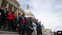 FILE - House Minority Leader Rep. Nancy Pelosi of California leads House Democrats down the steps of the Capitol building in Washington, June 23, 2016.