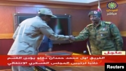 Sudan's General Mohamed Hamdan Dagalo is sworn-in as the appointed deputy of Sudan's Transitional Military Council, standing before Lieutenant General Abdel Fattah al-Burhan, right, in Khartoum, Sudan, April 13, 2019, in this image taken from video.