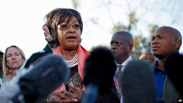 Winnie Madikizela-Mandela addresses the media in front the house of her former husband and former South African President Nelson Mandela in Soweto, June 28, 2013.