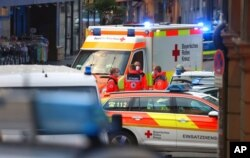 Emergency services vehicles are seen at the site of a knife attack, in Wuerzburg, Germany, June 25, 2021.
