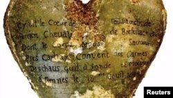 A heart-shaped lead urn with an inscription identifying the contents as the heart of Toussaint Perrien, Knight of Brefeillac, found during excavation of the ruins of the medieval Jacobins convent in Rennes.