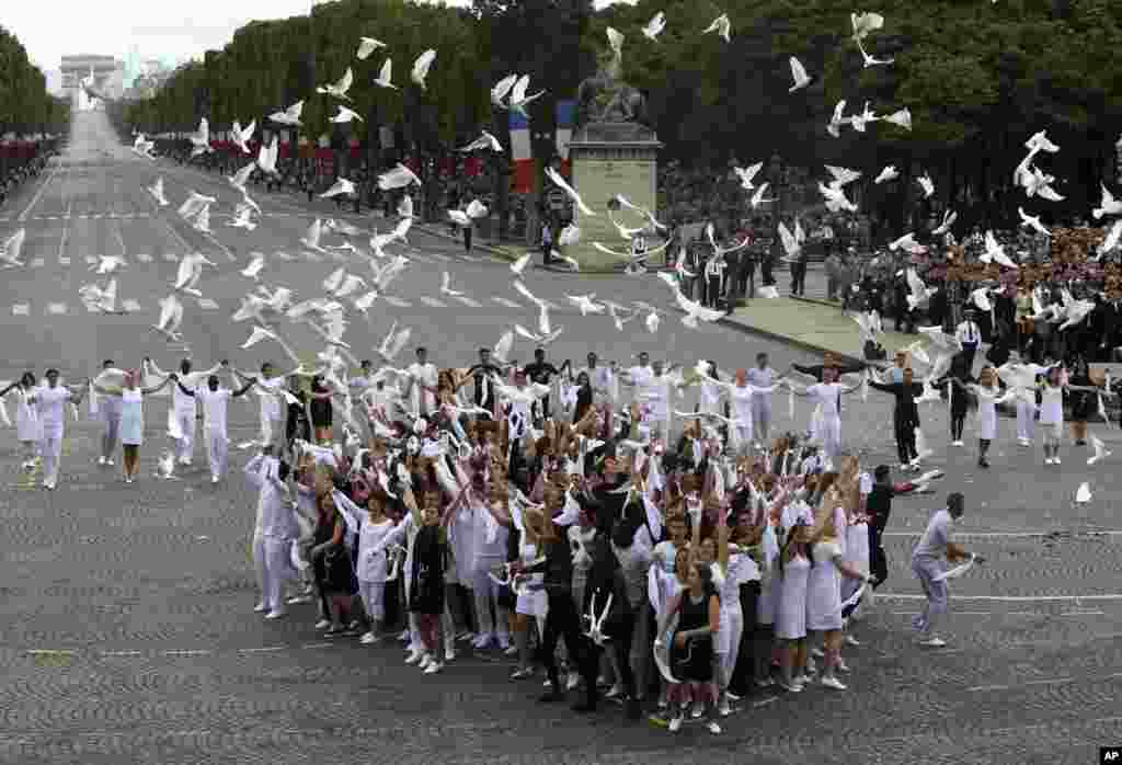 Dozens of doves are released after the Bastille Day parade in Paris, France, July 14, 2014.