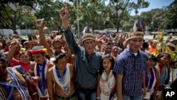 """FILE - Lawmaker Romel Guzamana, center, protests with supporters in Caracas, Venezuela, Jan. 13, 2016. Dozens of Indians under the cry of """"justice, justice,"""" protested the removal of three Amazonas state elected congress members from the National Assembly. Guzamana is one of three lawmakers who were barred by the Supreme Court from taking office due to irregularities during the election."""