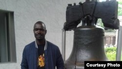 Stan Nyamanhindi at Liberty Bell, an iconic symbol of American Independence, in Philadelphia, Pennsylvania