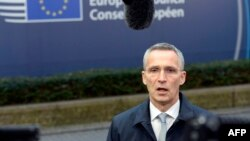 NATO Secretary General Jens Stoltenberg talks to the media upon his arrival to attend a European Union summit at the European Council building in Brussels, Dec. 15, 2016.