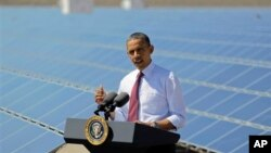 FILE - President Barack Obama speaks after touring a solar panel facility, Boulder City, Nevada, March 21, 2012.