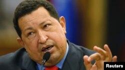 Tổng thống Venezuela Hugo Chavez nói chuyện tại một cuộc họp báo trong thủ đô Caracas của Venezuela sau khi tái đắc cử, 9/10/12