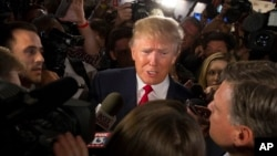 FILE - Republican presidential candidate Donald Trump speaks to reporters after the first Republican presidential debate at the Quicken Loans Arena in Cleveland, Aug. 6, 2015.